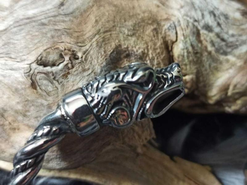 Solid stainless steel bracelet with wolf heads