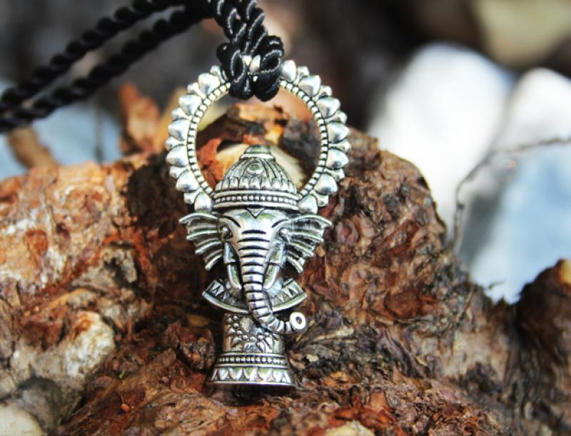 Playful Ganesha on rope chain