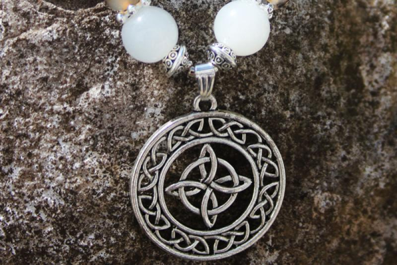 Celtic knot in milky jade and dragon vein agate