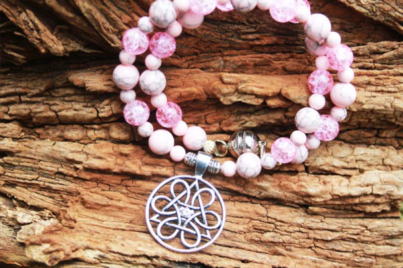 Slavic wheel of life on pink natural stone and crystal crush beads