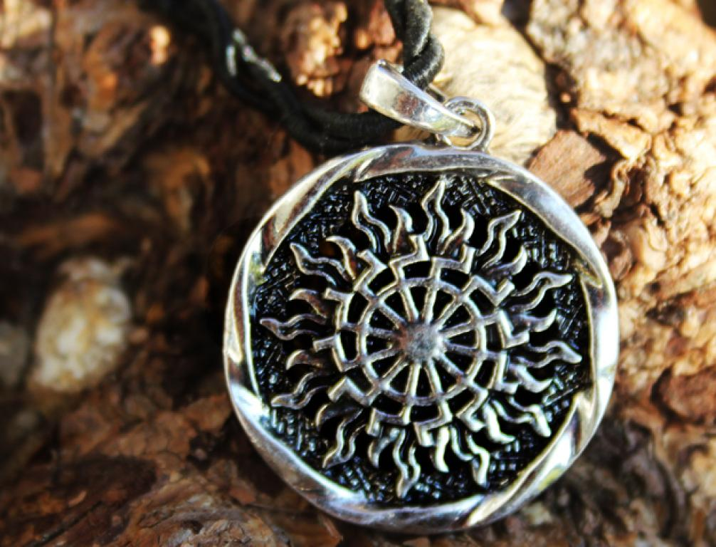 Black sun flame amulet